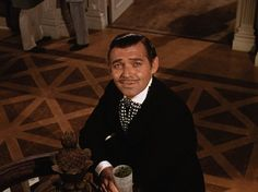"""Clark Gable as the scoundrel, Rhett Butler!  As Scarlett & her friend walk down the staircase at the Twelve Oaks BBQ, Scarlett whispers to her friend with her eyes wide, """"Why...he looks at me as though he knows what I look like without my chemise on.""""  And her friend replies, """"My dear!  Don't you know?  He isn't received!""""  I have that movie memorized."""