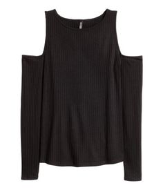 Black. Top in ribbed jersey with long sleeves and cut-out sections at the…