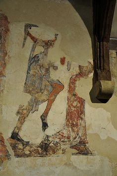 South Newington St Peter Ad Vincula church wall paintings on north wall martyrdom of St Thomas of Lancaster c1330 -34