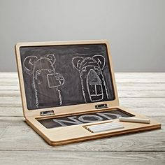 Want to keep the kids as lo-tech as possible for as long as possible? I love that this encourages creativity... And it's portable! // Byte-Size Personal Laptop Chalkboard  | The Land of Nod | $30