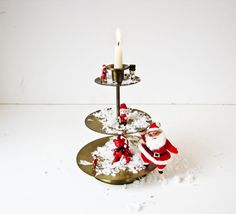 Unusual Brass Candlestick - 3 Tiers for Seasonal Display. $18.00, via Etsy.
