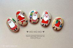 Santa painted on stones.