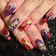 Purple, Coraly-Pink, Black and Gold with a Gold studded cross. Love it!!!