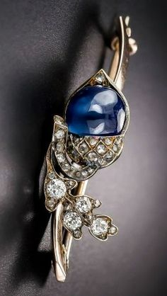 ANTIQUE SAPPHIRE AND DIAMOND ACORN PIN ~ Mid to late 19th century brooch depicting an oak leaf and acorn - symbol of strength and stability. Patinated silver over rose and yellow gold, with mine-cut diamonds set in the leaf and rose-cut diamonds set in the acorn top. The acorn is a 3 carat cabochon sapphire.