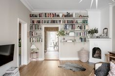 Gravity Home: Living room with fireplace and bookshelves above the door