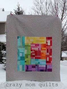Really like the idea of a quilt within a quilt.  Sew up some complex blocks & then frame (off-centered) with a solid color.  She quilted this like 2 quilts as well, the inside having a completely different quilting than then grey.