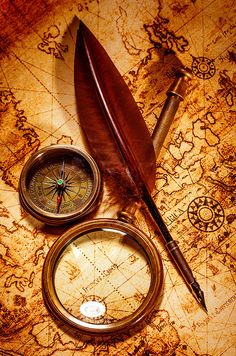 Vintage magnifying glass lies on an ancient world map is part of Ancient world maps - Vintage magnifying glass, compass, goose quill pen, spyglass lying on an old map Karten Tattoos, Map Compass, Compass Tattoo, Pirate Compass, Compass Navigation, Nautical Compass, Nautical Art, Map Tattoos, Arrow Tattoos