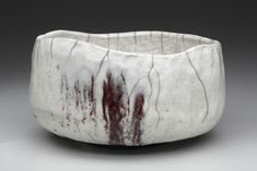 White chawan with a wavering rim. Pale crackled glaze reveals a dark surface. The white glaze is fragile and powerful at once, while the ice-like delicacy of the glaze contrasts with the rock-like surface underneath. Perfect for a winter chanoyu ceremony.