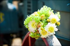 Beautiful Bridal Bouquet filled with greens, yellows and whites. Flowers arranged for a bride at South Pond Farms by Danielle French