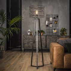 This Luca floor lamp ' has a hood in the form of a spiral with a diameter of 40 centimeters. The Luca floor lamp is provided with a tripod. The lamp is made of metal with a dark 'charcoal' color. Unique Floor Lamps, Industrial Floor Lamps, Industrial Design, Retro Lampe, Hallway Decorating, Bathroom Interior Design, Cool Lighting, Lamp Light, Living Room Designs