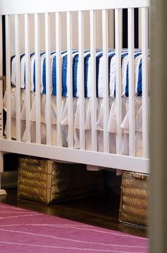 SMART use of space in the nursery - store bins of toys, etc. under the crib! #organization #storage #nursery
