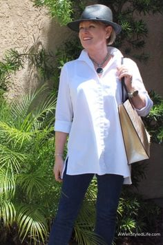 A classic white shirt with jeans and leopard shoes is casual and chic for running errands