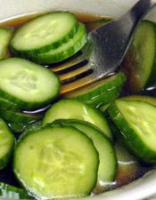 A sweet and sour dressing turns sliced seedless cucumbers into a perfect side for fish or other main courses.