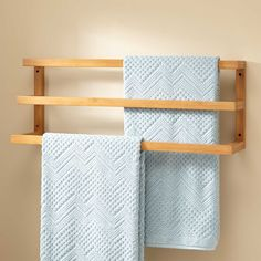 Featuring three bars to hold your linens, the Veska Bamboo Mounted Towel Rack is an eco-friendly addition to your bathroom. Designed to give your bathroom a polished look, this product is easy to install.