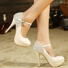 Cream Colored Heels with a Thin Ankle Strap & Crystal Studs on the Heels...Fierce!