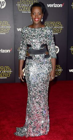 Lupita Nyong'o at the Star Wars: The Force Awakens premiere in an extraordinary silver and green crystal-encrusted Alexandre Vauthier Haute Couture gown with cut-outs and black satin bands at the waist.