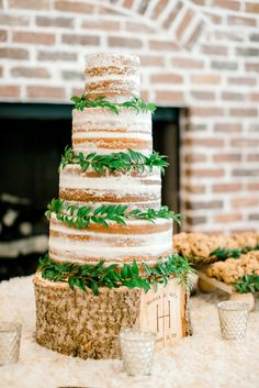 A gorgeous + natural naked wedding cake.  Love how simple it is with the white frosting, greenery around each layer, and the stump base.  A truly natural wedding cake! Taken at THE SPRINGS in Angleton, Magnolia Manor.  Follow this pin to our website for more information, or to book your free tour! Photographer:  Kaley Elaine Photography #weddingcake #nakedweddingcake #weddingcakeideas #weddingideas #naturalwedding #naturalweddingcake #weddingreception #weddingthemes