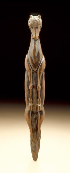 Vertical Horse. Japan, 18th century Netsuke.  Wood with inlays; sashi type 4 1/4 x 1 1/2 x 1 1/4 in. (10.8 x 3.8 x 3.1 cm) Raymond and Frances Bushell Collection. S)