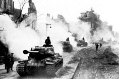 A convoy of Soviet heavy IS-2 tanks in the streets of Berlin, May 1945.  a photo from WWII Pictures Group