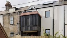 Scullion Architects adds charred-larch tower to terraced home in Dublin Upside Down House, Dublin House, Build My Own House, Timber Buildings, Timber Cladding, Street House, House Extensions, Amazing Architecture, Townhouse