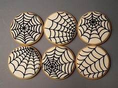 Different designs for spider web cookies.
