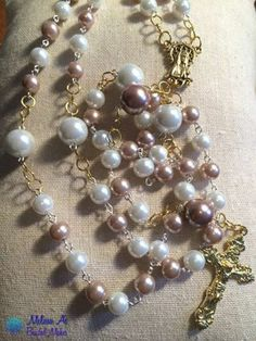 A FB buddy makes beautiful rosaries. This one is light coco brown and white glass-based pearls with gold-toned crucifix and centerpiece truly make this traditional rosary unique - $45.00 plus shipping.