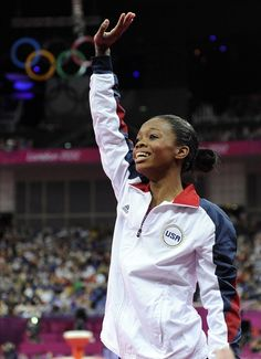 Gabby Douglas reacts to winning Gold in the women's gymnastics all around. She became the first African-American to win the all around and the third female gymnast in a row to win the medal for the United States.