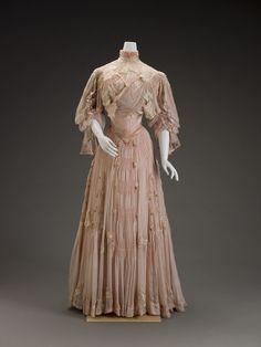 ornamentedbeing:  Dress, Girolamo Giuseffi, ca. 1906.  Silk and silk velvet. The appliquéd and cutout stylized flowers—either peonies or plu...