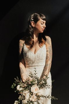 This bride's look is the perfect blend of modern style with retro flair. We love her Gatsby-esqe beaded gown, crescent hair piece, and especially her stunning tattoos.