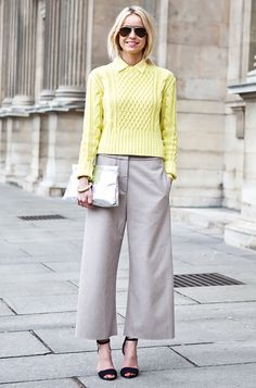 Cable knit sweater, polished wide-leg trousers, and black ankle strap heels