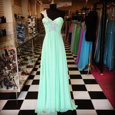 """""""We are dying over this new mint green dress! It is perfect for pageants, teen board, homecoming, or prom! Come shop our new red tag markdowns and layaway…"""""""