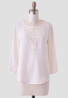 Crafted in airy chiffon, this breezy cream-colored top features intricate floral crochet detailing at the neckline and is adorned with gold-toned buttons. Finished with a back keyhole cutout, t...