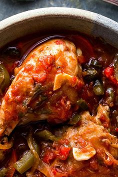 NYT Cooking: This is an adaptation of a classic French bistro dish, poulet Basquaise. The chicken is cooked in a pipérade of onion, garlic, hot and sweet peppers, tomatoes and, in the authentic version, cured ham, which I've omitted. In this version I use skinned chicken pieces. Serve with noodles, rice or other grains.