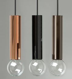 Pentagon pendant light by AfroditiKrassa. The body is covered with mirrored and tinted glass.