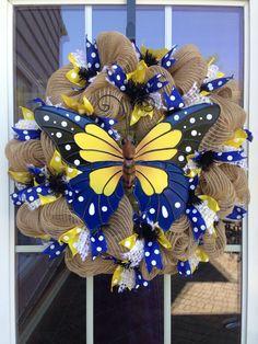 http://www.pinterest.com/alpeglowery/wreaths/  Butterfly mesh burlap wreath