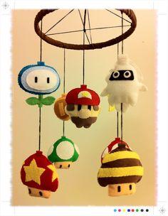 You are looking at a Mario Theme Baby Mobile! The mobile has 9 plush characters: Mario (center), Ice Flower, Bee Mushroom, Mushroom Up), Super Baby Nursery Themes, Baby Boy Nurseries, Nursery Decor, Geek Nursery, Nursery Ideas, Disney Diy, Nerd Baby, Eames, Stitch Disney