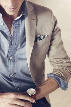 Light khaki blazer, with a light denim undershirt and a pocket square.