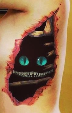 Cheshire Cat Tattoo Optical Illusion - http://www.moillusions.com/cheshire-cat-tattoo-optical-illusion/