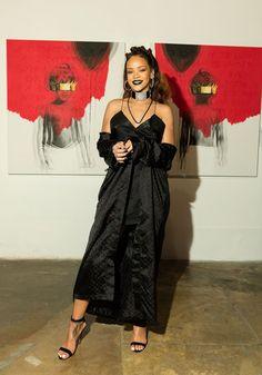 Rihanna 8th Album Artwork Reveal: Wearing a black Chrome Hearts coat & dress, Manolo Blahnik Chaos sandals at Anti album cover launch...