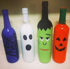 Decorate wine bottles in the Halloween spirit to serve as candle holders.  See more party and Halloween decoration ideas at one-stop-party-ideas.com