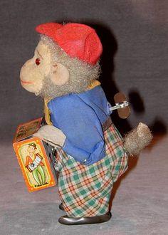Monkey Hurdy Gurdy Player Tin Toy