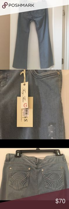 NWT Guess Jeans Size 28 NWT guess light blue jeans that I never wore. They are flared and are stretch material. 98% cotton and 2% spandex Guess Jeans Flare & Wide Leg