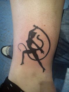 """""""Cat woman tattoo"""" - from the movie ~:^)>  http://www.youtube.com/watch?v=ePgLOVNMSTo"""