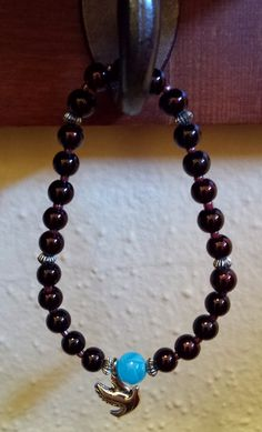 MYELOMA SUCKS BRACELET:   Dark burgundy beads for blood (myeloma is a plasma cell cancer). Sky blue bead for peace to carry you through challenging days. Dove charm for hope that better days lie ahead.