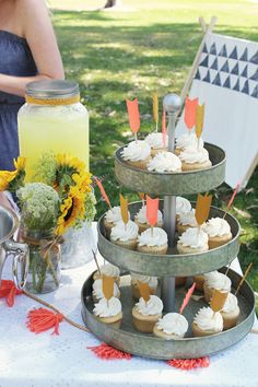 arrow cupcake toppers + yellow flowers + outdoor play tent... summer party!