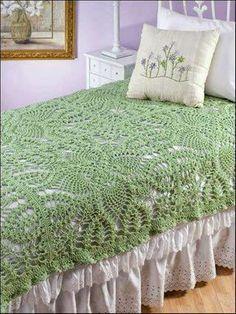 Colcha verde de crochê com gráfico