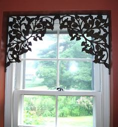 The Steampunk Home: The Hook Lady - These are shelf brackets, repurposed to frame a window --- what a clever idea. You could do this to define and separate spaces in the same room, too. (Say an entryway and a dining room.)