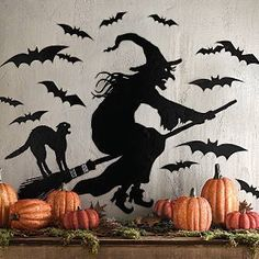 Witch and bat silhouettes. I wonder how hard this would be to make...
