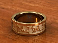 www.duckbandbrand.com  14K Gold, Deer antler band.  Made to order! call for pricing.   618-201-3312  Mon-Sat 9am to 6pm