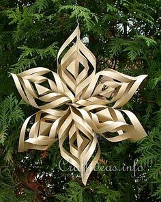 free Lacy Gold Paper Star Tree Ornament... Create these delicate and lacy stars to give your Christmas tree an elegant look. These stars are easier to craft than they look and one is completed within a half an hour. You can also enlarge the pattern and use heavier cardstock to create window decorations with these stars as well.